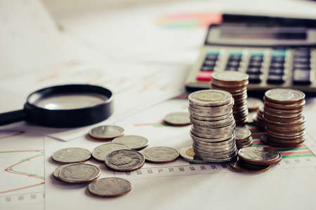 business and finance concept background, coins ,calculator and business chart o desk Imagens