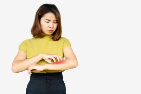Asian woman scratching her itchy arm cause of dry skin, food and drugs allergies ,dermatitis , skin problem concept