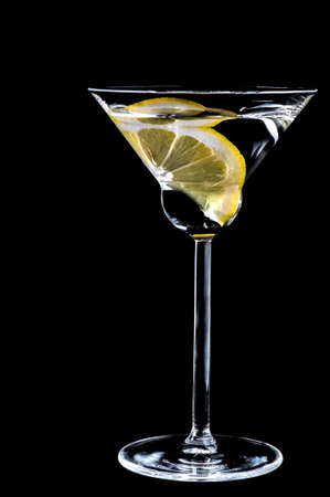 Lemon in a glass of cocktail isolated on the black Stock Photo - 19355543