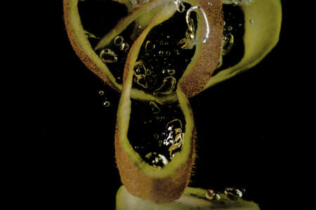 Kiwi fruit in water on a black background Stock Photo - 20867070