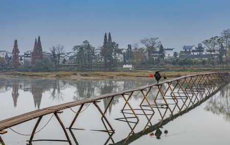 wooden bridge: Wuyuan ancient wooden bridge Stock Photo