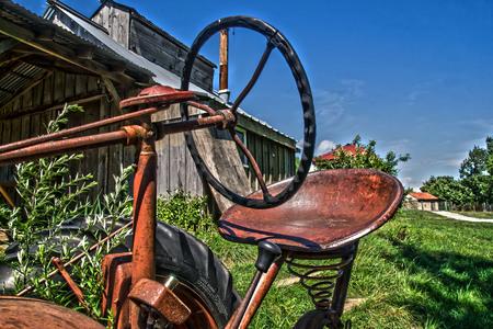an old farm tractor on an abandon farm