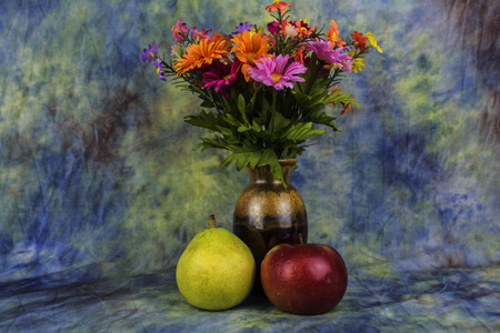 assorted flowers with an apple and pear.