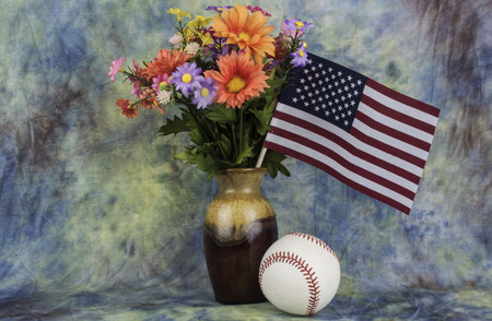 assorted flowers with a u.s. flagand a base ball.