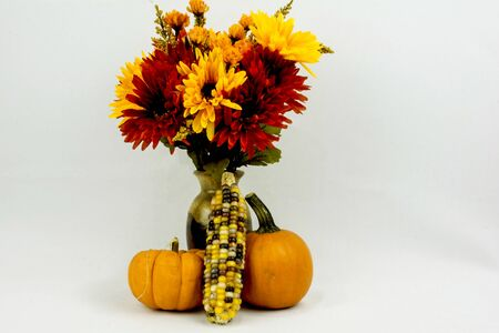 corn flower: assorted flowers with a pumpkin and indian corn. Stock Photo