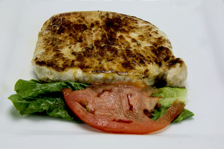 pork chop with lettuce and tomato Banco de Imagens
