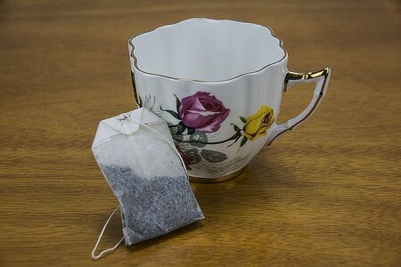 a tea cup with a tea bag