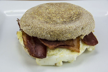 egg and bacon between english muffins