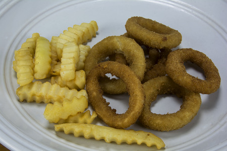 french fries and onion rings Banco de Imagens