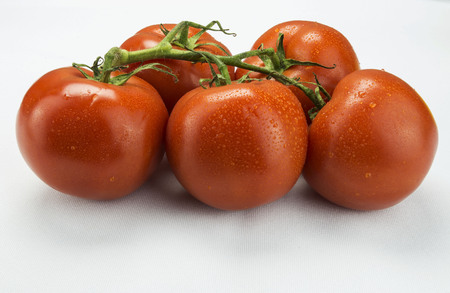 a cluster of tomatoes with water drops