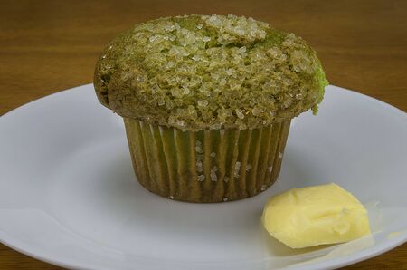 pistachio muffin with slice of butter Banco de Imagens