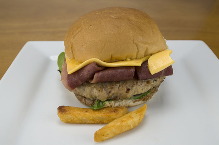 bacon cheese burger with french fries,