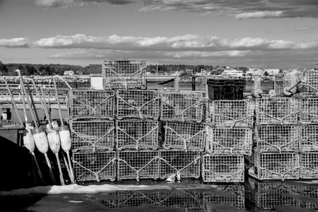 lobster traps and buoys lined the pier in new england.