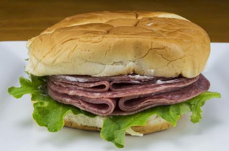 salami with lettuce on a bun