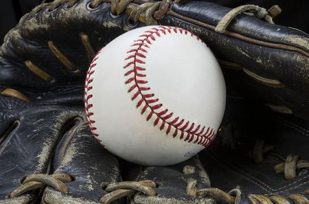 a base ball resting in an glove Zdjęcie Seryjne