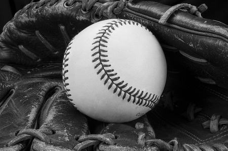 a base ball resting in a glove.