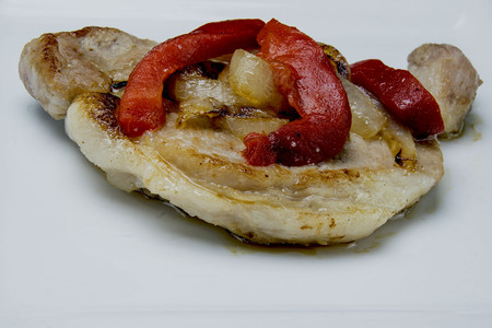 pork chgop with peppers and onions Banco de Imagens - 84969601