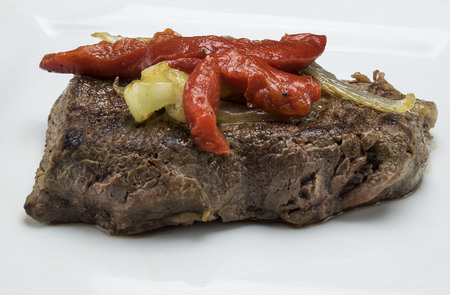 thick steak with onions peppers 版權商用圖片