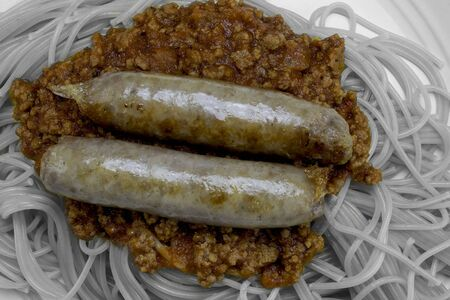 sausage with sauce in color and the rest in black and white.