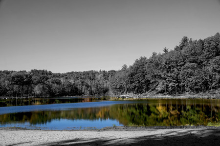 lake don in colr with the landscape in black and whiter Stock Photo