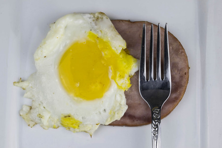 slice of ham with an egg.