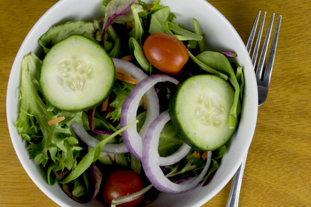toss salad with a fork