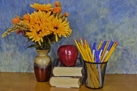 flowers books and a apple