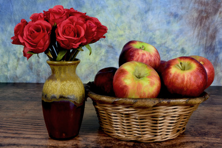 roses with a basket of apples