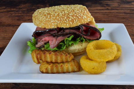roast beef with fries and onion rings