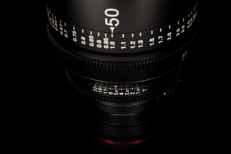 Professional Cinema Lens - camera lenses on the mirroring black background.