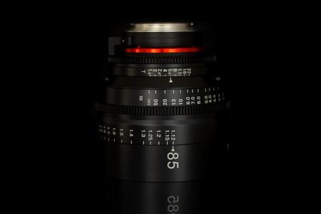 Professional Cinema Lens - camera lenses on the mirroring black background.