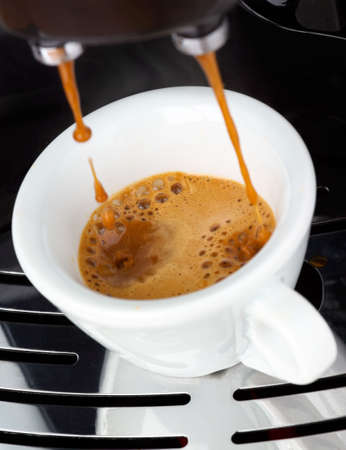 coffee machine: Fresh steaming espresso coffee being made Stock Photo