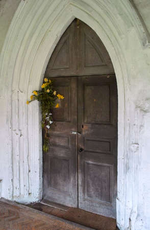 english village: Medieval English village Church door Stock Photo