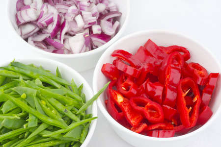 tout: Fresh vegetables!  Diced peppers, onion and mange tout Stock Photo