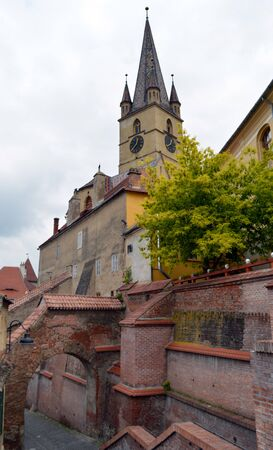 protestant: Sibiu Romania: walkway and Protestant cathedral Stock Photo