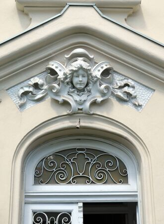 statuary: Bucharest Romania: Detail above doorway near Piata Romana