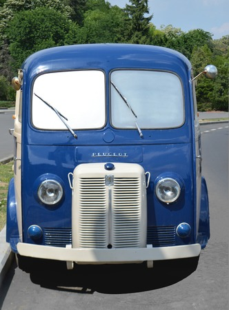 restored: Restored blue French delivery van parked in Bucharest