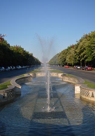 unification: Looking down Unirii Boulevard through a fountain towards Piata Unirii Unification Square