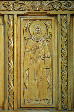 princely: Wooden door with carved representation of Saint Anthony on church bearing his name in the Old Princely Court Curtea Veche in Bucharest, Romania