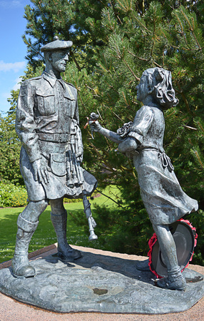 dutch girl: A bronze memorial on the North Inch, Perth, Scotland to those who served in two world wars in the 51st Highland Division, the first Allied troops to cross the Rhine in the Second World War. The sculpture shows a little Dutch girl presenting a Scottish sol