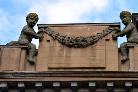 Cherubs, now without wings, on tp of Perth City Hall, Scotland