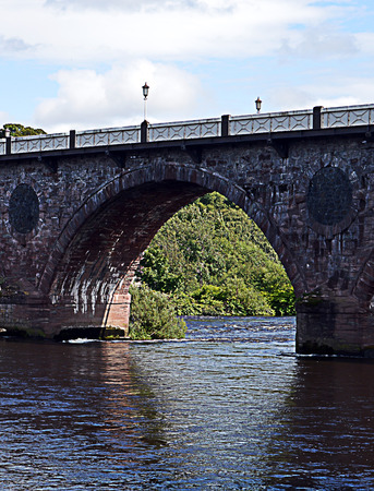 brig: One arch of John Smeatons nine arch masony bridge 1766-71, the Auld Brig, over the River Tay in Perth, Scotland. Shows the decorative rings infilled by black whinstone.