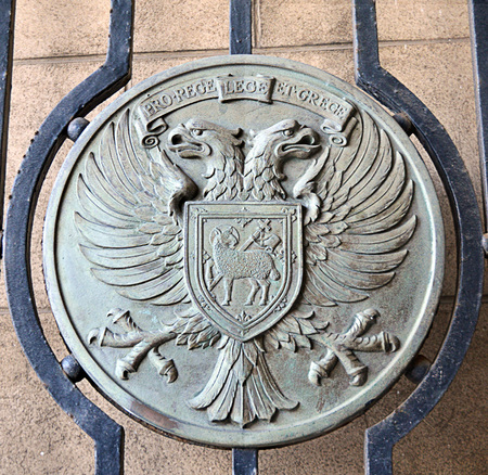 city coat of arms: Circular cut-out from a gate on a former building of Perth City Council the council being replaced by Perth and Kinross in 1975 in Tay Street, Perth.