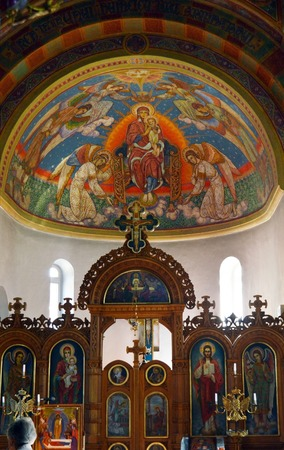 iconostasis: Brightly coloured dome depicting Mary holding Jesus Christ and being crowned Queen of Heaven above the iconostasis, separating the nave from the sanctuary, in a Greek-Catholic Byzantine rite church in Bucharest, Romania Editorial
