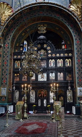 iconostasis: Interior of a Romanian Orthodox church in Bucharest, Romania showing the iconostasis, with icons of saints and separating the nave from the sanctuary Editorial