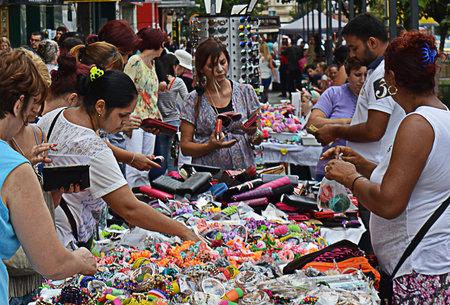 bargains: Shopping for bargains at stalls in Piata Unirii, Bucharest, Romania