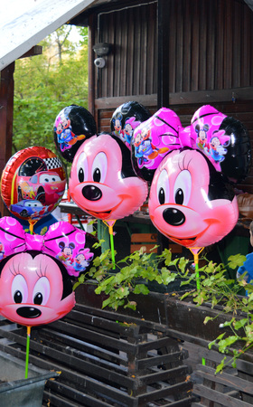 minnie mouse: Minnie Mouse balloons on a stall in Cismigiu Park. Bucharest, Romania