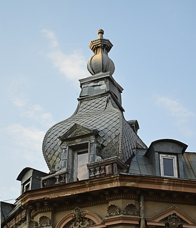 mansard: Typical neo-Romanian mansard window form on building in Stirbei Voda, Bucharest. Stock Photo
