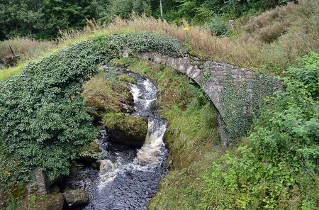 span: Stone single span bridge over the River Barvick iat Monzie, Perthshire, Scotland Stock Photo