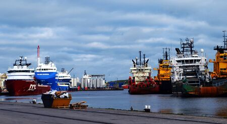 quay: Oil supply vessels moored at Regent Quay, Aberdeen, Scotland Editorial